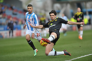 Nahki Wells of Huddersfield Town is beaten to the ball by Miguel Llera of Sheffield Wednesday during the Sky Bet Championship match at the John Smiths Stadium, Huddersfield<br /> Picture by Graham Crowther/Focus Images Ltd +44 7763 140036<br /> 22/02/2014