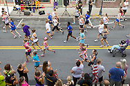 Middletown, New York - Female runners head down North Street at the start of the 2012 Run 4 Downtown road race on Saturday, Aug. 18, 2012. Females started 4 minutes, 21 seconds before the males in the four-mile race.