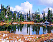early autumn snow and clouds reflecting in Reflection Lake, Mt. Rainier National Park, Washington State