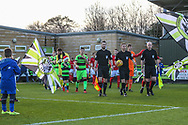 The teams enter the field of play during the EFL Sky Bet League 2 match between Forest Green Rovers and Crewe Alexandra at the New Lawn, Forest Green, United Kingdom on 22 December 2018.