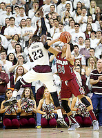 South Carolina's Michael Carrera (24) is fouled by Texas A&M's Danuel House (23) during the first half of an NCAA college basketball game, Saturday, Feb. 6, 2016, in College Station, Texas. South Carolina won 81-78. (AP Photo/Sam Craft)