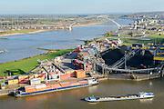 Nederland, Gelderland, Nijmegen, 24-10-2013. Noordkanaalhaven, gelegen aan de kruising van de Waal en het Maas-Waalkanaal. Containerterminal en overslag van kolen.<br /> Bruggen De Snelbinder en De Oversteek.<br /> Nederland, Gelderland, Nijmegen, 24-10-2013. Noordkanaalhaven, gelegen aan de kruising van de Waal en het Maas-Waalkanaal. Containerterminal en overslag van kolen.<br /> <br /> Port in Nijmegen (central Netherlands), container terminal and transshipment of coal. The river Waal and its bridge.<br /> <br /> luchtfoto (toeslag op standaard tarieven);<br /> aerial photo (additional fee required);<br /> copyright foto/photo Siebe Swart.