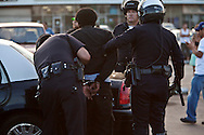A protester was arrested in the Mid-City area of LA.<br /> Protesters march through out South Los Angeles in response to the not guilty verdicts in the Trayvon Martin verdict in Florida.