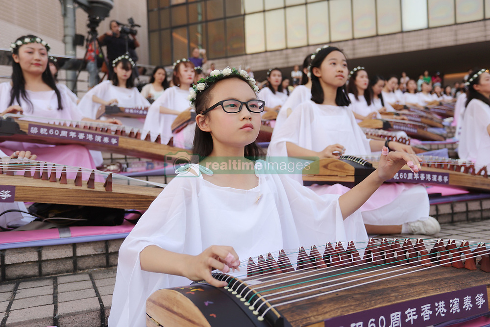 October 4, 2018 - Hong Kong, CHINA - Young students perform traditional music pieces on Chinese classic harps outdoor as part of continued China national day celebration in Hong Kong.Oct-4,2018 Hong Kong.ZUMA/Liau Chung-ren (Credit Image: © Liau Chung-ren/ZUMA Wire)