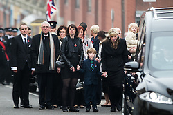 © Licensed to London News Pictures . 02/11/2015 . Liverpool , UK . The front of the funeral procession . The funeral of Police Constable Dave Phillips , at Liverpool Cathedral . Five people are charged in connection with his death , including Clayton Williams , 18 , from Wallasey , who is charged with murder . Photo credit: Joel Goodman/LNP