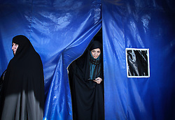 Voters leaves after casting their ballots at a polling station in the city of Qom, Iran, on Feb. 26, 2016. Elections for Iran's parliament (Majlis) and Assembly of Experts kicked off at 8 a.m. local time (0430 GMT) on Friday. EXPA Pictures © 2016, PhotoCredit: EXPA/ Photoshot/ Ahmad Halabisaz<br /><br />*****ATTENTION - for AUT, SLO, CRO, SRB, BIH, MAZ only*****