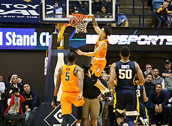 Feb 10, 2018; Morgantown, WV, USA; Oklahoma State Cowboys guard Jeffrey Carroll (30) dunks the ball in the final seconds to beat the West Virginia Mountaineers at WVU Coliseum. Mandatory Credit: Ben Queen-USA TODAY Sports