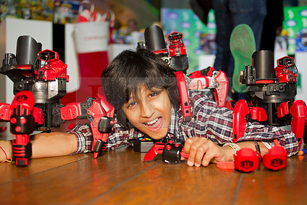 © Licensed to London News Pictures. 31/10/2012. London, UK. 11 year old Dillon Mitra plays with a set of WowStuff 'Attacknid' robots (RRP GB£69.99) in London today (31/10/12) as the Toy Retailers Association releases its 13 Dream Toys for Christmas 2012. Photo credit: Matt Cetti-Roberts/LNP