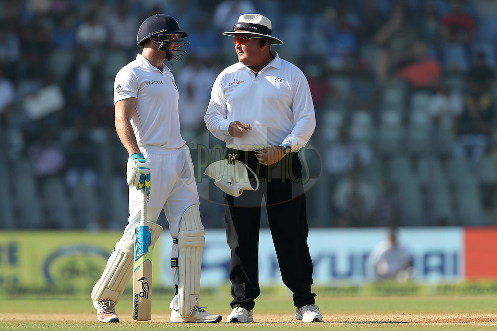 Umpire Marais Erasmus and Jos Buttler of England  have words during day 5 of the fourth test match between India and England held at the Wankhede Stadium, Mumbai on the 12th December 2016.<br /> <br /> Photo by: Ron Gaunt/ BCCI/ SPORTZPICS