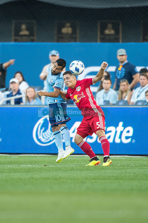 July 8, 2018 - Bronx, New York, United States - New York City midfielder MAXIMILIANO MORALEZ (10) fights for a header against New York Red Bulls defender CONNOR LADE (5) during a regular season match at Yankee Stadium in Bronx, NY.  New York City FC defeats the New York Red Bulls 1 to 0 (Credit Image: © Mark Smith via ZUMA Wire)