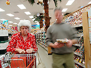 Elderly woman waiting in line for the cashier.