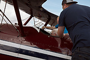 Volunteer prepping for flight in N3N at Warbirds Over the West.