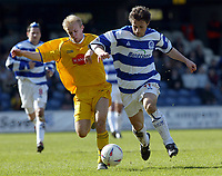 PHOTO: GERARD FARRELL/ DZ PICS<br /> QPR V STOCKPORT.<br /> NATIONWIDE DIVISION TWO.<br /> DATE: 17\04\2004.<br /> QPR'S GARETH AINSWORTH FIGHTS FOR THE BALL WITH STOCKPORTS DANNY JACKMAN