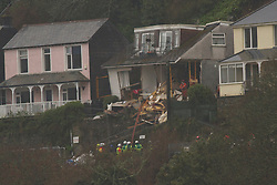 © Licensed to London News Pictures. 22/03/2013. Looe, UK. The remains of a house that collapsed after heavy rain caused a land slide on Sandplace Road, Looe this morning. A body has been found this afternoon, It has yet to be identified but is presumed to be that of the homeowner. Photo credit: Ashley Hugo/LNP