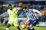 Millwall forward Lee Gregory (9), Peterborough United midfielder Anthony Grant (42) during the EFL Sky Bet League 1 match between Millwall and Peterborough United at The Den, London, England on 28 February 2017. Photo by Sebastian Frej.
