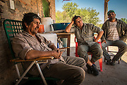2014/11/23 – Quimili, Argentina: Raúl Eduardo Leal (56) talks with member of his community Paulo Esteban (48) and Juan Yedro (44) at his house on the Guaycurú Indigenous Community of Bajo Hondo. He complains how the soy producers are deforestation the area around his community. The region around Quimili on the Santiago Estero Province is being vastly converted from forestland into fields to produce soy, detroying the habitats for local species and indigenous people. (Eduardo Leal)