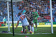A scuffle breaks out in the goal net between Joel Lynch of Huddersfield Town and Johnny Russell of Derby County after Thomas Ince of Derby County scores his teams 4th goal. Skybet football league championship match, Huddersfield Town v Derby county at the John Smith's stadium in Huddersfield, Yorkshire on Saturday 18th April 2015.<br /> pic by Chris Stading, Andrew Orchard sports photography.