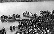 Pontoons, flat-bottomed boats whose military use was to ferry troops across a river, or as the supports for a floating bridge. French soldiers waiting their turn to be taken across the water, c1914.