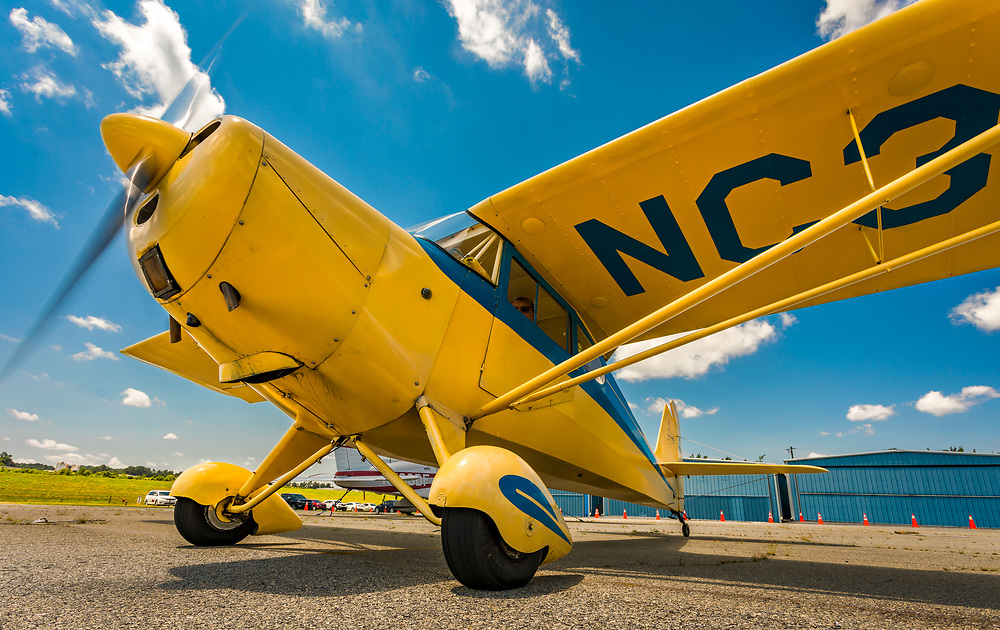 An Aeronca Chief begins to taxi out with an EAA Young Eagle on board.<br /> <br /> Created by aviation photographer John Slemp of Aerographs Aviation Photography. Clients include Goodyear Aviation Tires, Phillips 66 Aviation Fuels, Smithsonian Air & Space magazine, and The Lindbergh Foundation.  Specialising in high end commercial aviation photography and the supply of aviation stock photography for advertising, corporate, and editorial use.