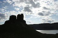 Dramatic sunlight backlights clouds and the two sisters rock formation, named as part of Native American legend in Eastern Washington by the Columbia River. (Photo by John Froschauer)