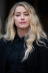 © Licensed to London News Pictures.<br /> 28/07/2020.  London, UK. American actress AMBER HEARD talks to the members of press outside the High Court in central London where Johnny Depp is in a legal dispute with UK tabloid newspaper The Sun over allegations he assaulted his former wife, Amber Heard. Photo credit: Marcin Nowak/LNP