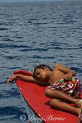 boy sleeping in front of boat, Christmas ( Kiritimati ) Island, Line Islands, Kiribati ( Central Pacific ) MR 300