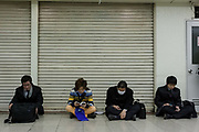 People wait for Shibuya station to open so can begin the journey home after a magnitude .9 earthquake hit the Tohoku region of north east Japan causing tremors in Tokyo that stopped the train and cellphone networks. Many people were stranded in the centre of Tokyo over night. Tokyo, Japan Friday March 11th 2011