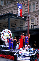 Stock photo of Miss Juneteenth 1999 and her court ride on a float through downtown