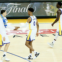 01 June 2017: Golden State Warriors guard Klay Thompson (11) congratulates Golden State Warriors guard Patrick McCaw (0) and Golden State Warriors forward Draymond Green (23) during the Golden State Warriors 113-90 victory over the Cleveland Cavaliers, in game 1 of the 2017 NBA Finals, at the Oracle Arena, Oakland, California, USA.