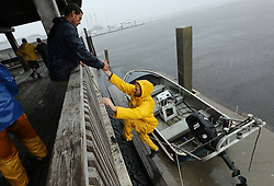 October 7, 2016 - Mcdonough, GA, USA - Crew members of the tall ship Peacemaker leave after securing the ship's dinghy on a dock as Hurricane Matthew begins to hit the area with wind and heavy rain on Friday, Oct. 7, 2016, in Saint Marys, Ga. Very significant coastal flooding is expected. (Credit Image: © Curtis Compton/TNS via ZUMA Wire)