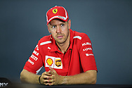 SINGAPORE - SEPTEMBER 16: Sebastian Vettel (5) of Scuderia Ferrari during the Driver Press Conference at F1 Singapore Grand Prix 2018, Marina Bay Street Circuit, Singapore on September 16, 2018. <br /> .<br /> .<br /> .<br /> (Photo by: Naratip Golf Srisupab/SEALs Sports Images)<br /> .<br /> Any image use must include a mandatory credit line adjacent to the content which should read: Naratip Golf Srisupab/SEALs Sports Images