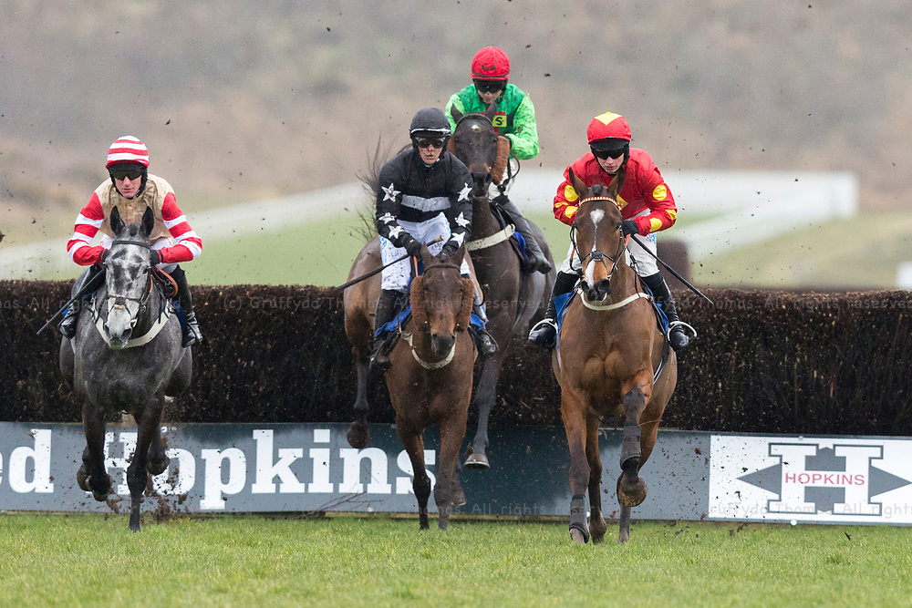 Ffos Las Racecourse, Trimsaran, Wales, UK. Sunday 18 February 2018.  Lord Bryan (jockey James Bowen) (right) and Two Hoots (jockey Nick Scholfield) lead the field in the PT Civil Engineering Novices' Handicap Chase