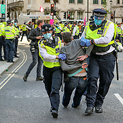 Police drag a protestor after the arrest them in Parliament Square, central London on Tuesday, Sept 1, 2020. Ten days of climate change demonstrations have begun as Extinction Rebellion (XR) take to the streets across the UK.  (VXP Photo/ Vudi Xhymshiti)