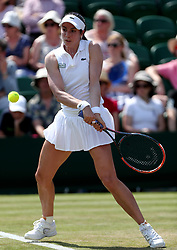 Christina McHale in action against Agnieszka Radwanska on day four of the Wimbledon Championships at The All England Lawn Tennis and Croquet Club, Wimbledon.