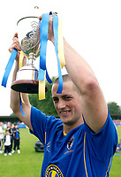 Picture by Daniel Hambury.<br /> 23/07/05.<br /> AFC wimbledon v Football Club United of Manchester. Pre season friendly.<br /> Micky Woolner lifts the Supportsers Direct Cup.