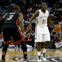 Oct 23, 2013; New Orleans, LA, USA; New Orleans Pelicans point guard Jrue Holiday (11) is guarded by Miami Heat shooting guard Dwyane Wade (3) during the first half of a preseason game at New Orleans Arena. Mandatory Credit: Derick E. Hingle-USA TODAY Sports