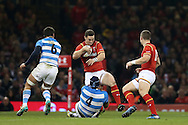 George North of Wales © is stopped by Guido Petti of Argentina (4). Under Armour 2016 series international rugby, Wales v Argentina at the Principality Stadium in Cardiff , South Wales on Saturday 12th November 2016. pic by Andrew Orchard, Andrew Orchard sports photography