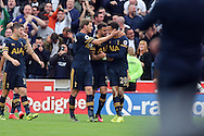 Dele Alli of Tottenham Hotspur (r) celebrates with his teammates after scoring his teams 3rd goal. Premier league match, Stoke City v Tottenham Hotspur at the Bet365 Stadium in Stoke on Trent, Staffs on Saturday 10th September 2016.<br /> pic by Chris Stading, Andrew Orchard sports photography.