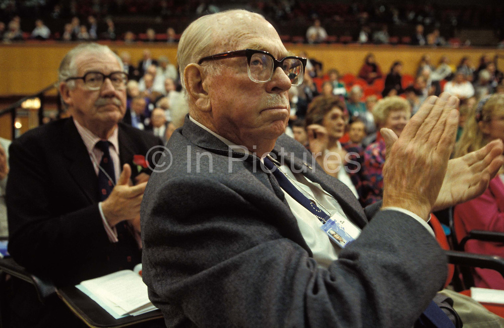 A Conservative Party delegate applauds Prime Minister John Majors closing speech at the 1992 Conservative Party Conference, on 18th March 1992, in Brighton, England. John Major went on to win the general election weeks later and was the fourth consecutive victory for the Tory Party although it was its last outright win until 2015 after Labours 1997 win for Tony Blair.