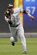 Chicago White Sox left fielder Alejandro De Aza makes a running catch on a fly ball from Kansas City Royals' Eric Hosmer during the fourth inning of a baseball game against the Kansas City Royals at Kauffman Stadium in Kansas City, Mo., Sunday, May 5, 2013.  (AP Photo/Colin E. Braley).