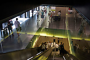 Visitors and escalator in London's Tate Modern art gallery.