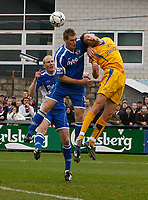 Photo: Steve Bond/Sportsbeat Images.<br /> Torquay United v Exeter City. The FA Blue Square Premier. 01/01/2008. Chris Todd (R) is oyjumped by Matt Taylor (L)