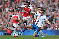 Scott Dann of Crystal Palace tackles Danny Welbeck of Arsenal. Barclays Premier league match, Arsenal v Crystal Palace at the Emirates Stadium in London on Sunday 17th April 2016.<br /> pic by John Patrick Fletcher, Andrew Orchard sports photography.