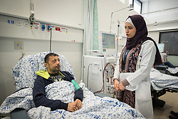 24 February 2020, Jerusalem: Social worker Ranz Izhiman (right) tends to patient Ismael Khader from Jerusalem (left), who visits Augusta Victoria Hospital to receive Dialysis treatment.