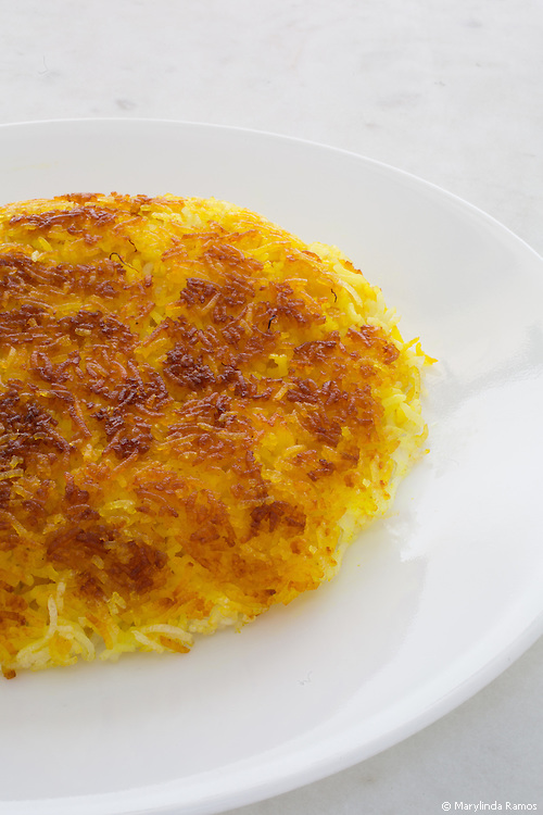 The finished product.  Saffron, yogurt, and olive oil are added to half a recipe of steamed basmati to form a slightly crunchy, golden crust.