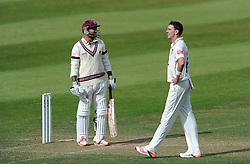 Dejection for sussex's Steve Magoffin as Somerset's Peter Trego looks on - Photo mandatory by-line: Harry Trump/JMP - Mobile: 07966 386802 - 06/07/15 - SPORT - CRICKET - LVCC - County Championship Division One - Somerset v Sussex- Day Two - The County Ground, Taunton, England.