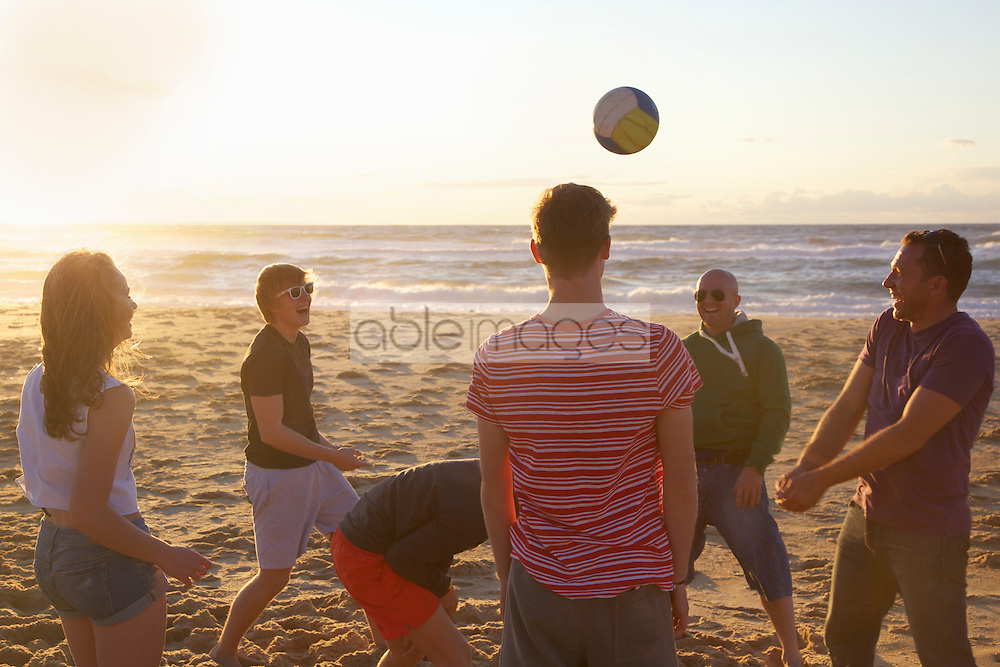 Group of People Playing Volleyball on Beach