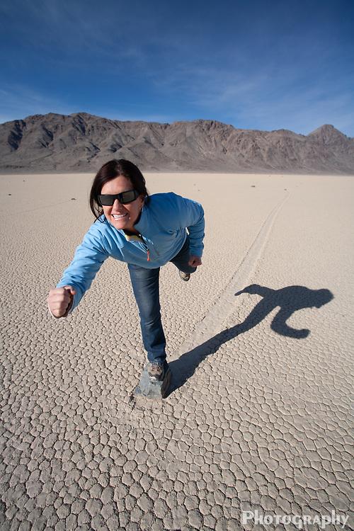 Woman balances on sliding rock in the desert