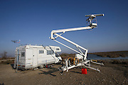 SURVEILLANCE MIGRATING BIRDS, Camargue. Mobile unit. New technology surveillance using radar and satellite, tracking technology mapping movements of migrating wildlife. France, Provence, wildlife park and nature reserve, swampland region between Arles and Saintes Maries de la Mer. Many wild birds especially known for thousands of pink flamingoes migrating and living there all year around. Fears of bird  flu arrival with migrating birds from overseas.