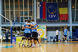 Players of Calcit Kamnik celebrate during CEV cup 1/16 volleyball game between Calcit Kamnik and Aquacare Halen on October 19, 2011 at Sportna dvorana, Kamnik, Slovenia. (Photo By Matic Klansek Velej / Sportida)